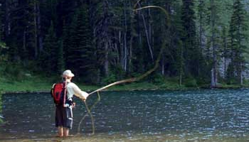 Casting to cutthroat trout on Alpine Lake